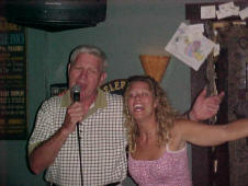Lucy and Joe Baby singing at The Swizzle Inn in Bermuda.